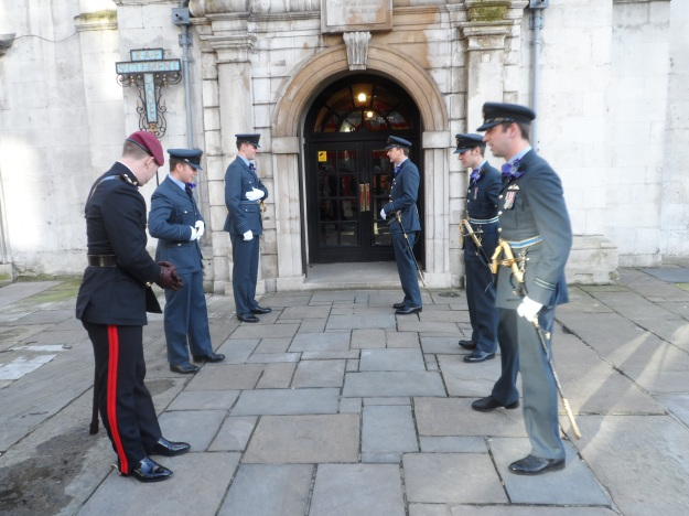 Outside the RAF Chapel.  Both guys at the front look like younger versions of Prince William and Prince Harry.   Unfortunately, they weren't!