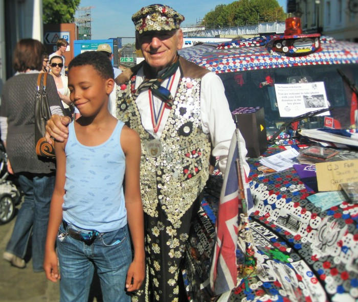 """The Tall Young Gentleman"" with the Pearly King in London."