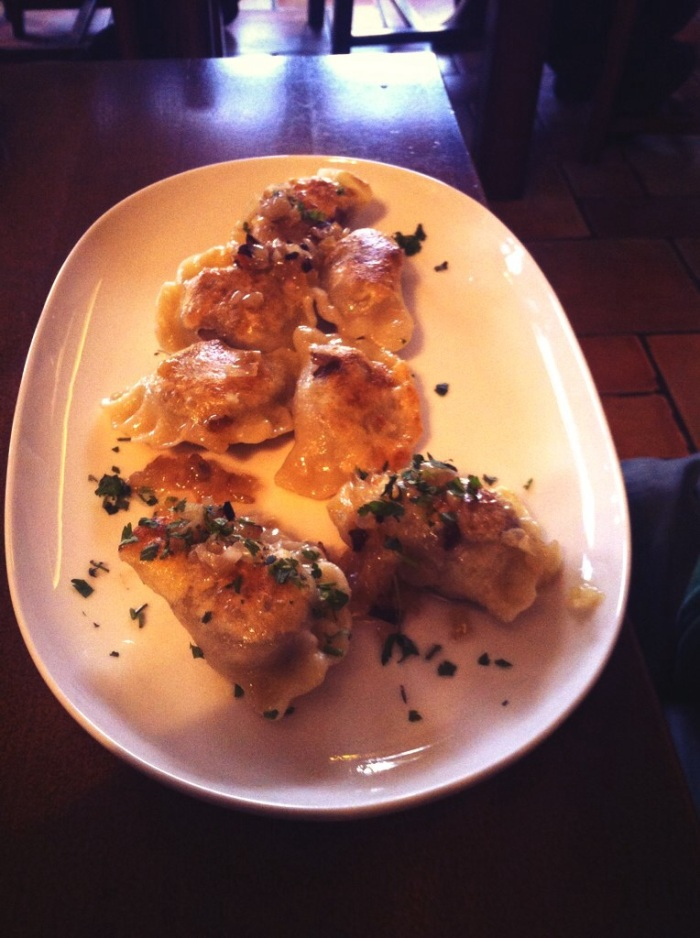 Polish Pierogi with bacon bits. We had the Russian Pierogi too, and they were both just as delicious LOL!