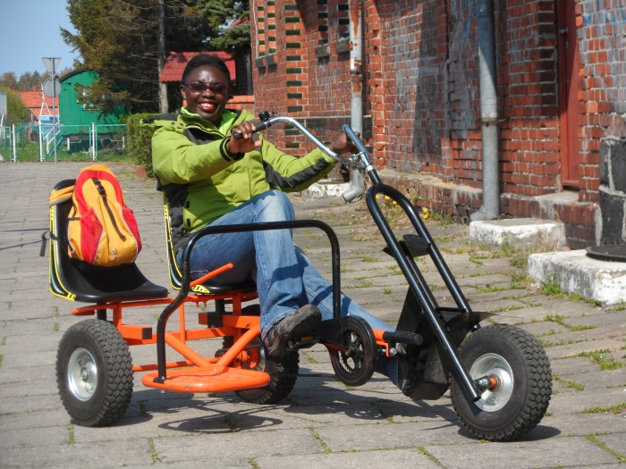 On the city-kart in Leba, Poland before the chain and seat broke off!