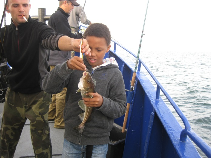 Catching a fish on the Polish Baltic Sea.