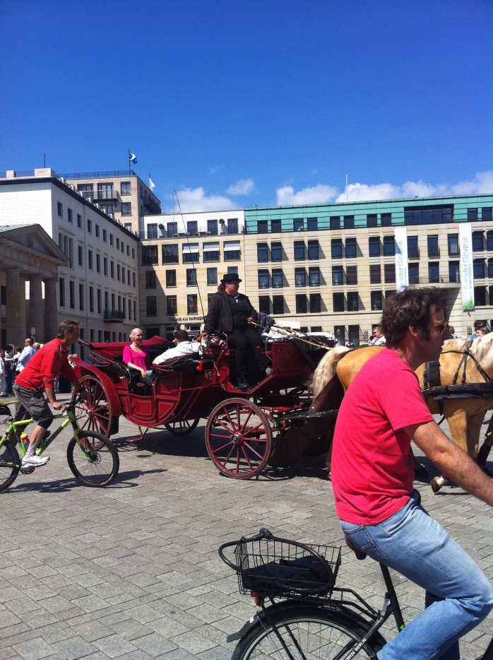 A romantic form of transport: A horse and trap at Brandenburger Tor or Gate, and bicycles!