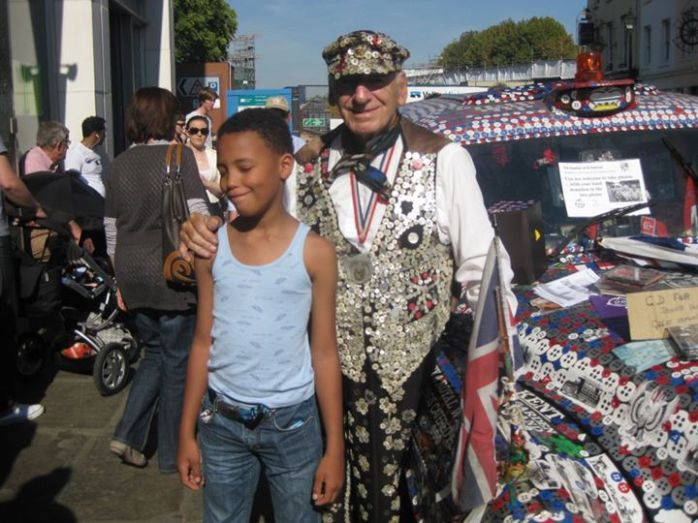 """""""The Tall Young Gentleman"""" with the Pearly King in London."""
