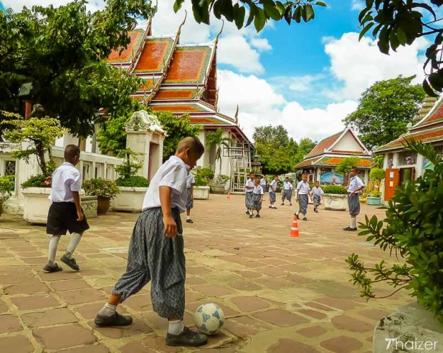 Thai kids playing football.
