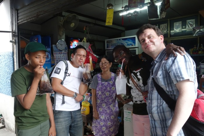 Drinking through a plastic bag and a straw in Bangkok, Thailand. Our faces were scrunched up 'cos the crushed ice was bloody freeeeezing cold!