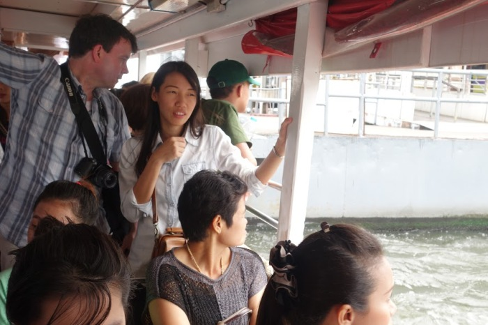 """""""The Music Producer"""" and Cherie, on one of the longtail boats!"""