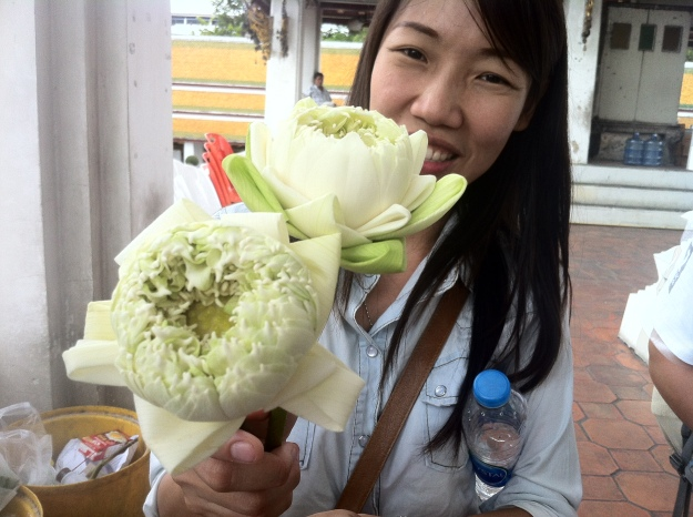 Cherie with those beautiful flowers at the temple in Bangkok, Thailand.
