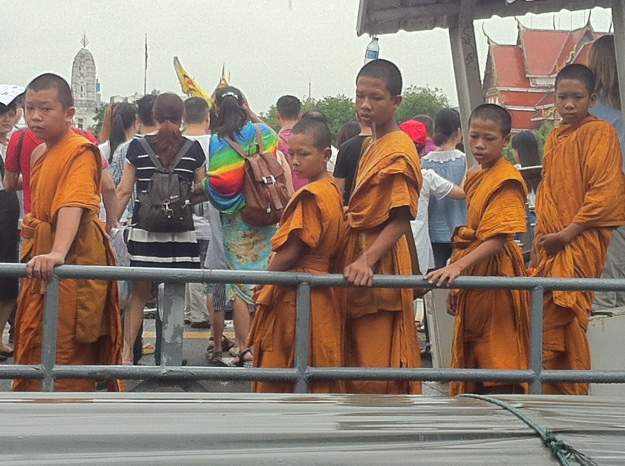 Young teenage monks going to school in Bangkok, Thailand.