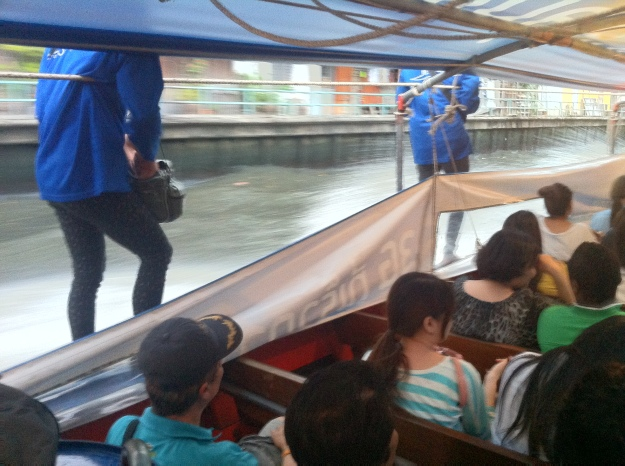 The boat conductors on the longtail boats!