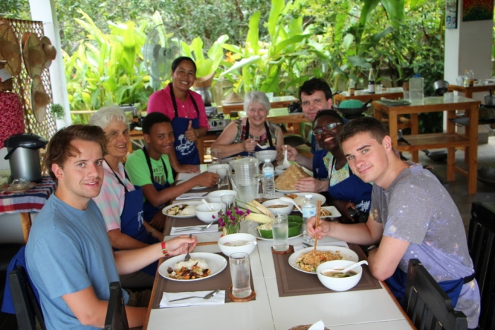 Happily noshing around the dining table at the Thai Secret Cooking School in Chiang Mai!