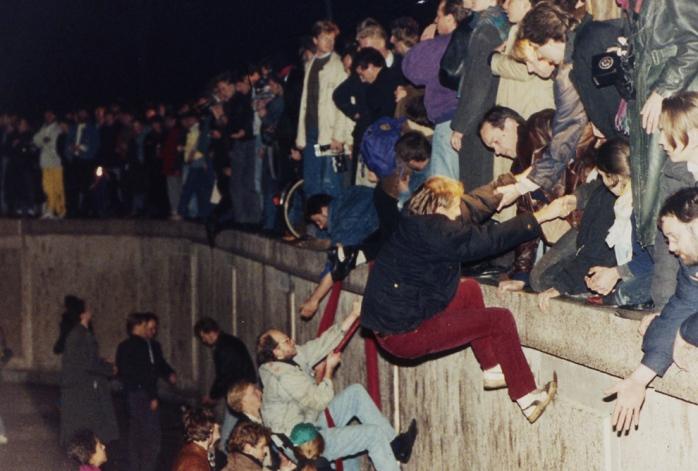 Climbing up the Berlin Wall. Freedom! Freedom!!