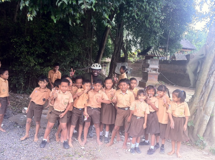 Local children and myself (can you see me?) squatting in Bali!