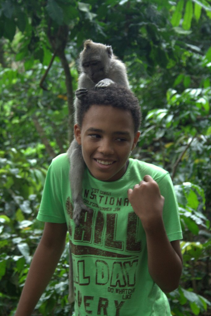 Ouch! I'm still smiling. I'm still smiling! Even though there's a monkey on my head in Bali! Photo @Frank Böster