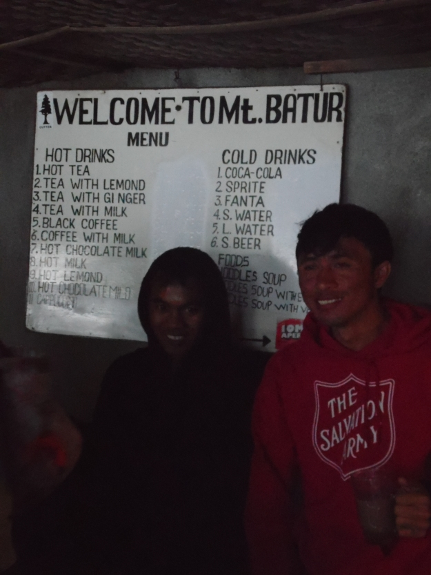 Some of the licensed trekking guides on top of Mount Batur, Bali.