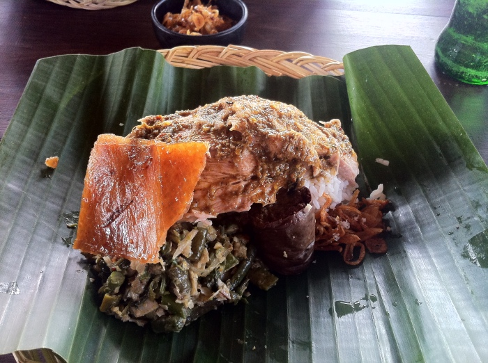 Suckling pig on a palm leaf, in Bali. Eating food the local way!