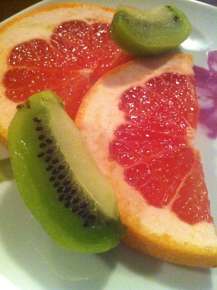 Fresh oranges and kiwi slices.