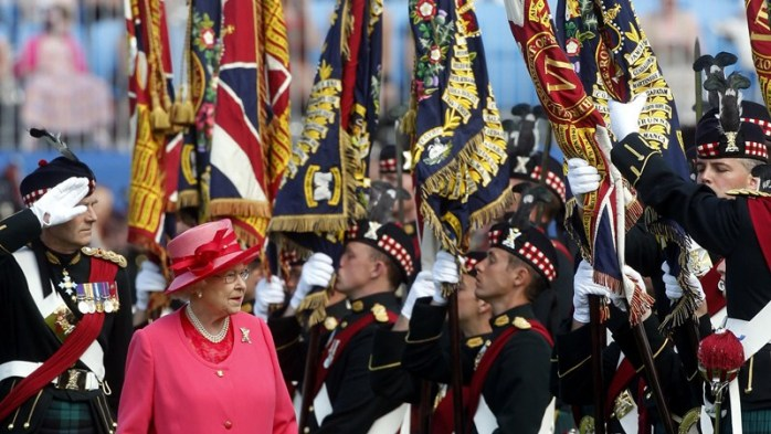 Queen Elizabeth II as she presented the new Colours to the Royal Regiment of Scotland by symbolically touching each Colour, during a ceremony at Holyrood Park in Scotland.