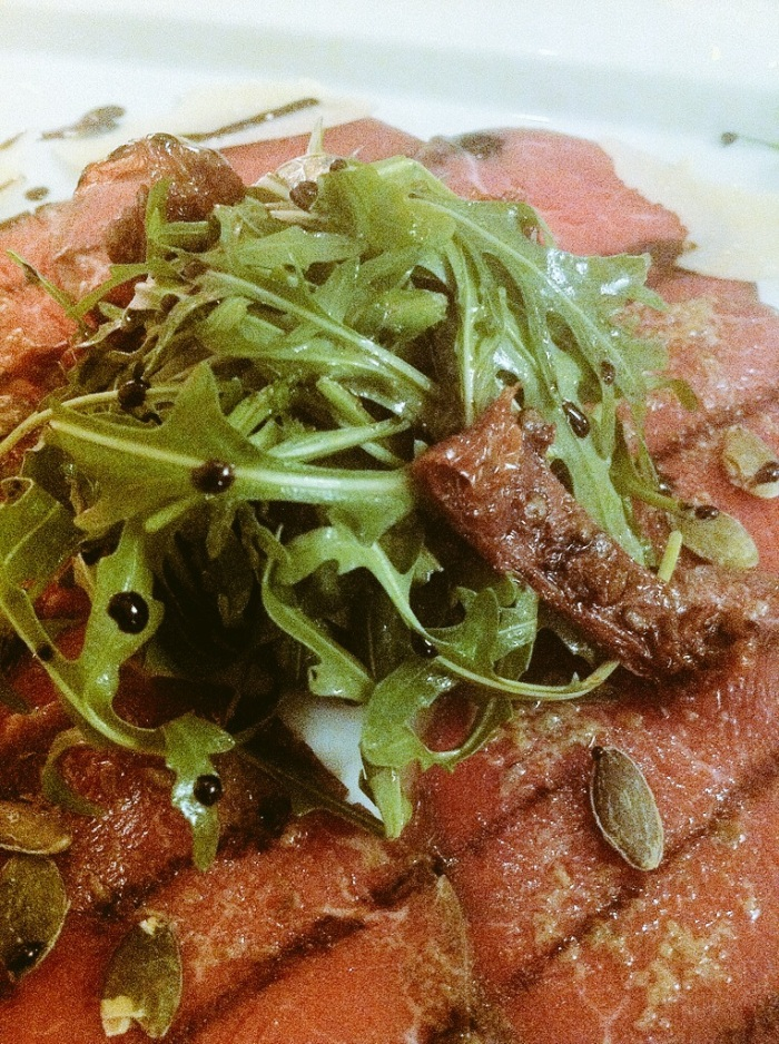 Carpaccio of beef with rocket salad, parmesan cheese and balsamico at My City Hotel, Tallinn.
