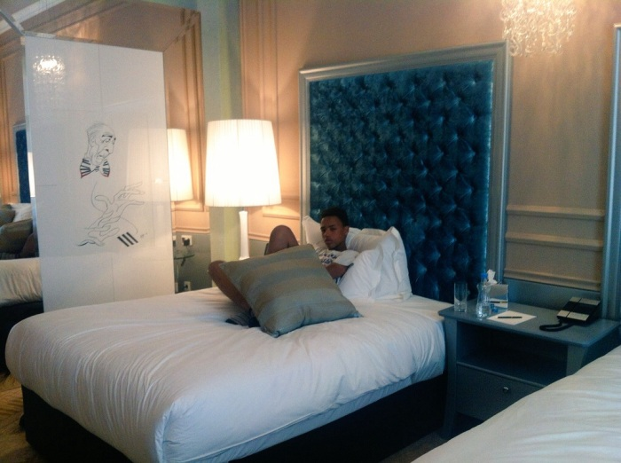 """The Tall Young Gentleman"" relaxing in the the Grand Luxury Room and with 2 Full-Size Beds - Aria Hotel."