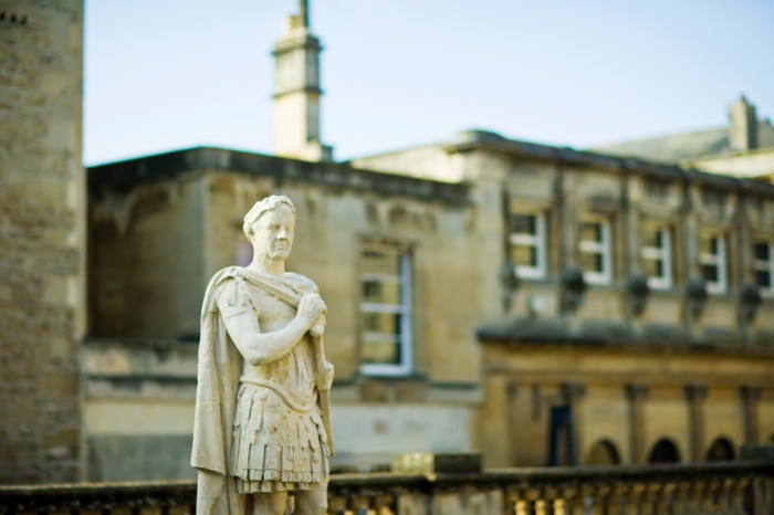A close up of a statue outside the Roman Baths. ©VisitBritain Simon Winnall