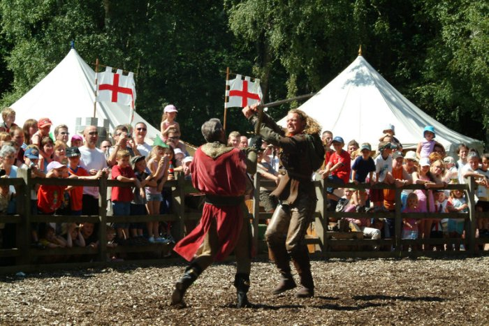 Hundreds of people watch a re-enactment of a fighting scene, Sherwood Forest, Nottinghamshire