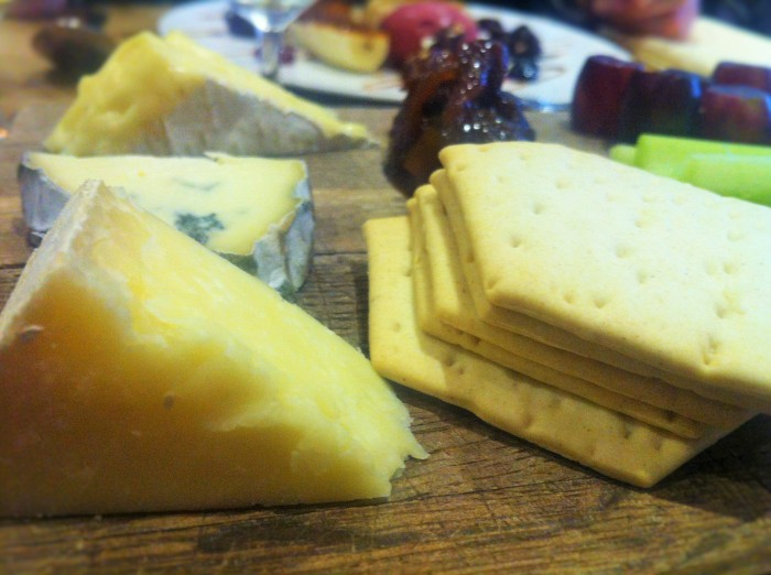 A wooden platter of cheese with a classic garnish, crackers and seasonal chutney at the Chef's Table in Chester!