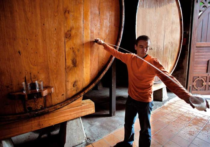 Spanish cider poured in a certain way or collected in a glass and drunk straight from the barrel! ©foodswinesfromspain.com