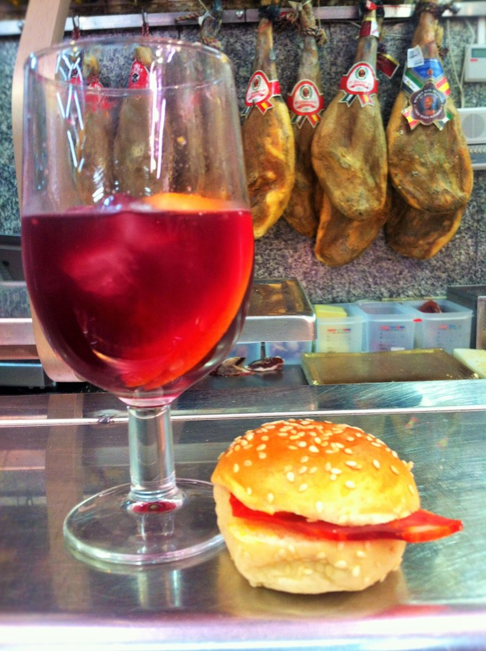 A Spanish Tinto de Verano (sangria) and chorizo tapas in a bun at the Museo del Jamon in Madrid.