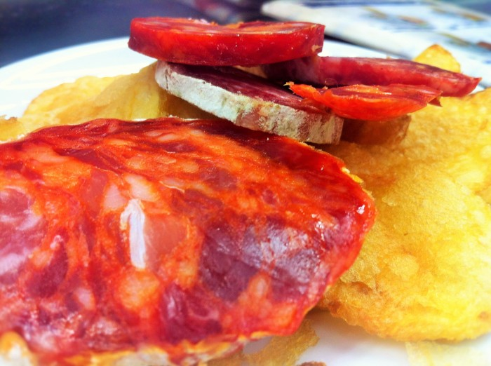 Spanish chorizo and crisps (potato chips) tapas. On our own at the Museo del Jamon in Madrid!