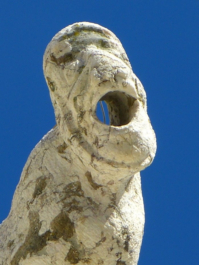 He doesn't speak Portuguese either! He's a scary water-spout gargoyle in Lisbon!