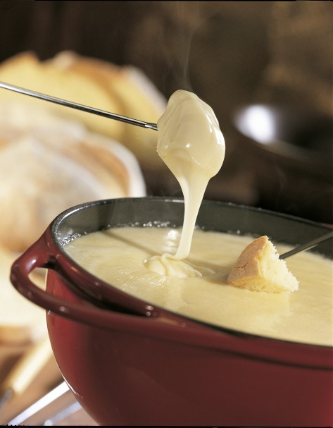 Cheese fondue - Swiss cheese melted in a huge communal pot! Why you should visit Switzerland, and eat cheese!