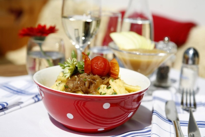 Älplermagronen - a bake with macaroni, potatoes, onions, bacon, & cheese, served with apple sauce! Why you should visit Switzerland, and eat cheese!