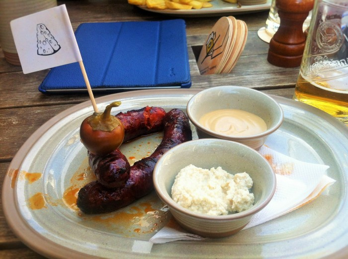 The bravcova klobasa - a Slovakian grilled pork sausage served with mustard, horseradish and a pepper!