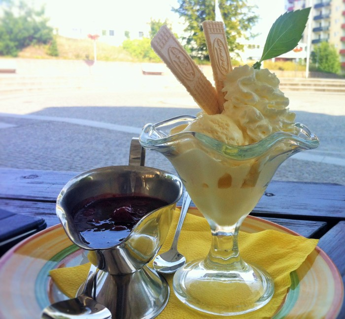 Vanilla ice-cream scoops, wafer sticks, clotted cream and a silver jug of strawberry sauce!