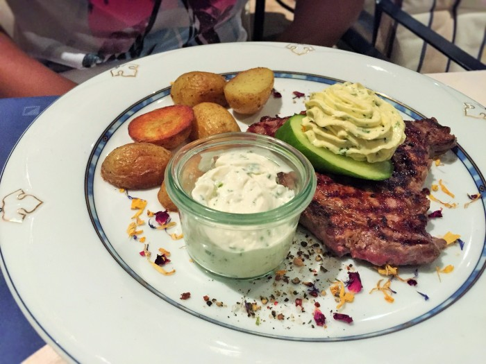 Grilled steak with roast pototaoes, a cucumber covered with lemony creamy butter, served with herby sour cream! ©The Music Producer - Frank Böster