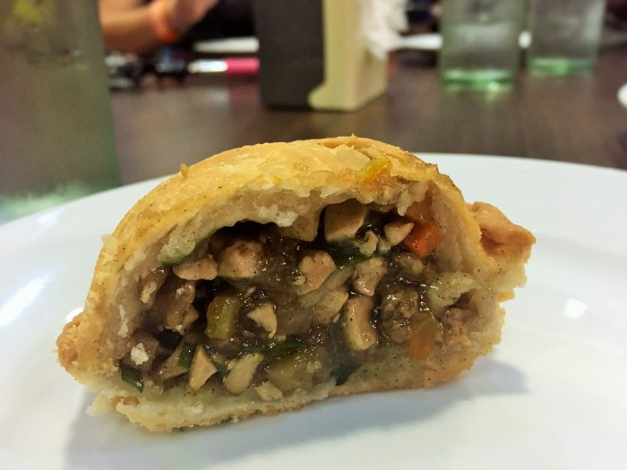 Empanada de kaliskis - a traditional flaky, pastry filled chicken pie - sweet to taste, filled with tasty ingredients, and a hefty crunch!