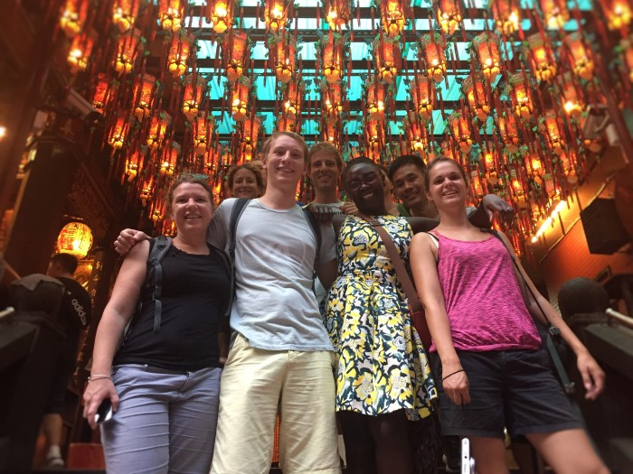 Making new friends under the glowing lanterns of the Mengjia Longshan Temple, in Taipei!